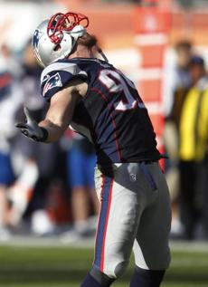 Patriots defensive end Trevor Scott celebrated after sacking Tannehill during the second half.